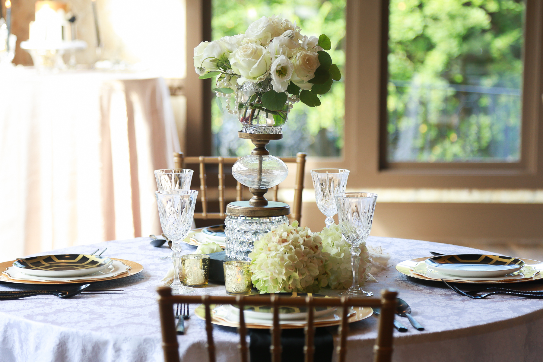 A table with flowers and vases