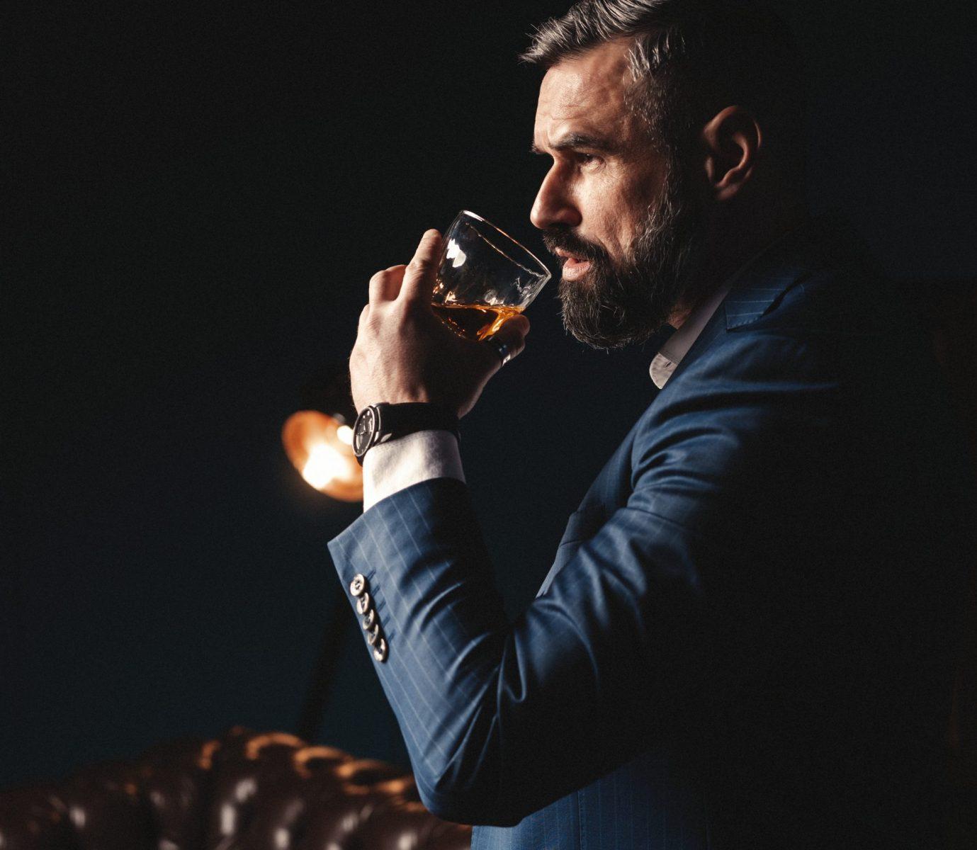 A dapper gent tasting whiskey